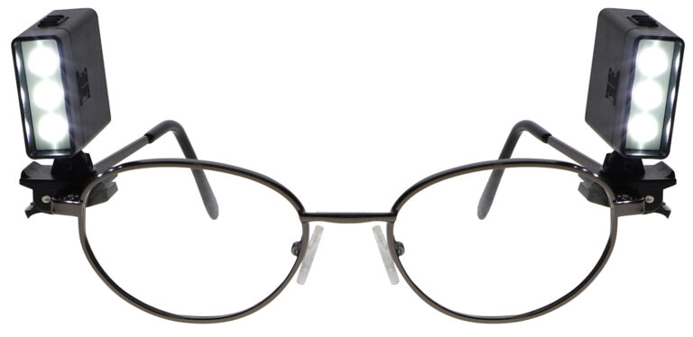 LED Clip-On Light Turned on, attached to glasses